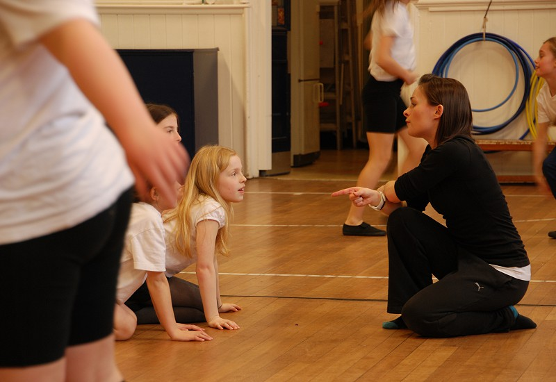 A picture of dancer Jen Ward from Born and Bred Dance Theatre collaborating with school children