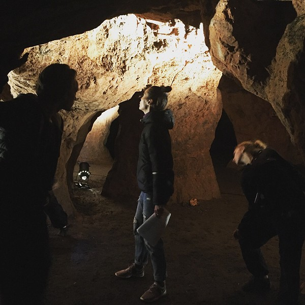 Dancers and musician rehearsing in Redcliffe Caves, Bristol for performances of Beneath Our Feet