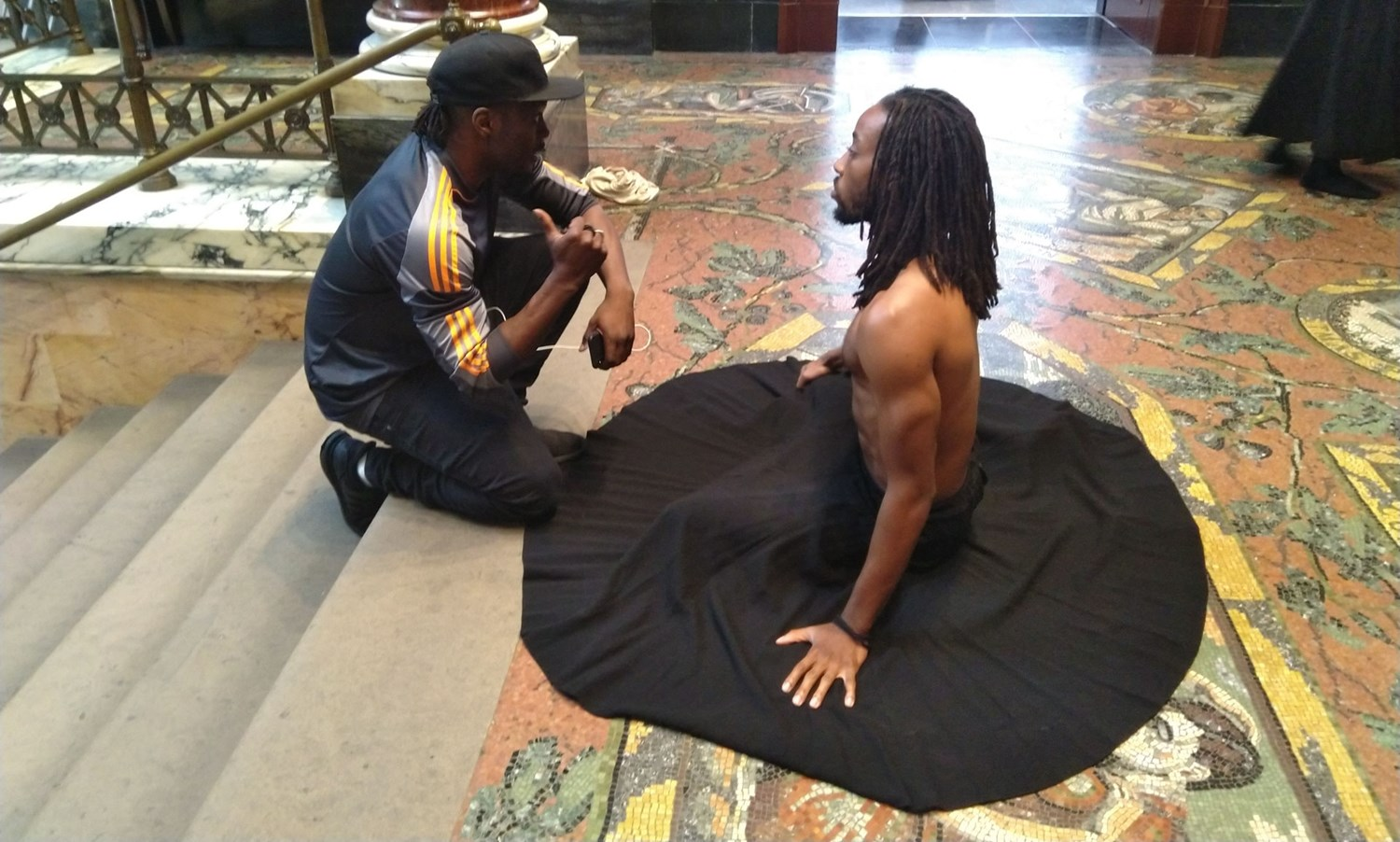 Choreographer Tony Adigun rehearsing with dancer Ajani Johnson-Goffe in the National Gallery's Portico
