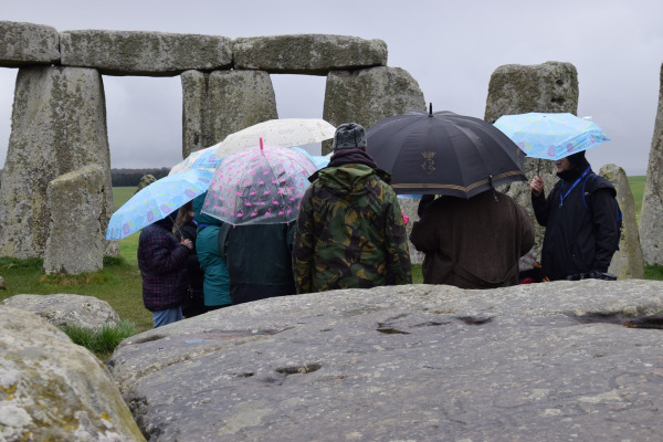 A group of people meet for the Human Henge project at Stone Henge
